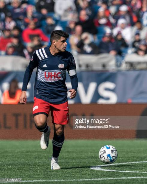 Gustavo Bou of New England Revolution looks to pass during a game between Chicago Fire and New England Revolution at Gillette Stadium on March 7 2020...