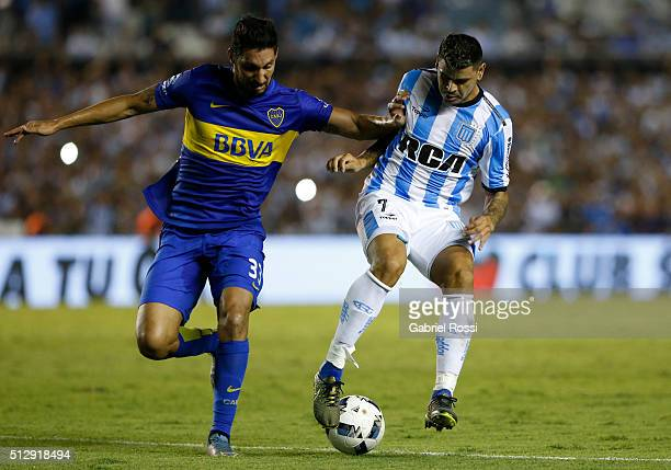 Gustavo Bou of Racing Club fights for the ball with Juan Manuel Insaurralde of Boca Juniors during a fifth round match between Racing Club and Boca...