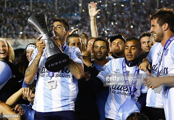 Gustavo Bou of Racing Club kisses the trophy celebrating the championship after winning a match between Racing Club and Godoy Cruz as part of 19th...
