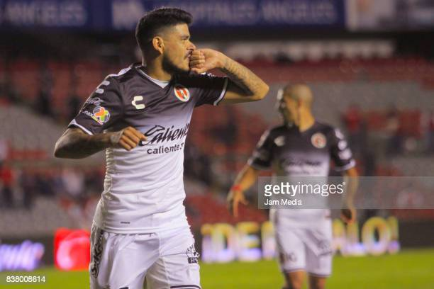 Gustavo Bou of Tijuana celebrates after scoring his team's third goal during the 6th round match between Queretaro and Tijuana as part of the Torneo...
