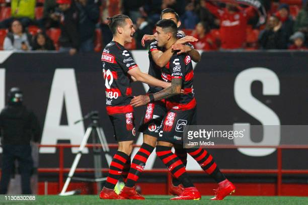 Gustavo Bou of Tijuana celebrates with teammates after scoring the first goal of his team during a match between Tijuana and Pachuca as part of the...