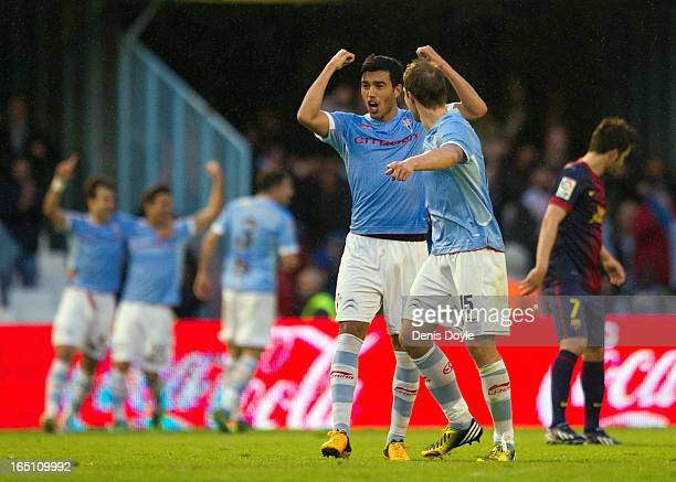 Gustavo Cabral and Marc Bartra of RC Celta de Vigo celebrate after their team scored their 2nd goal during the La Liga match between RC Celta de Vigo...