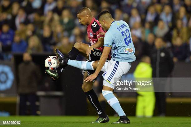 Gustavo Cabral of Celta de Vigo competes for the ball with Deyverson of Alaves during the Copa del Rey semifinal first leg match between Real Club...