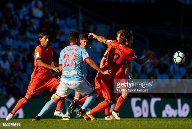 Gustavo Cabral of Celta de Vigo competes for the ball with Mikel Oyarzabal of Real Sociedad during the La Liga match between Celta de Vigo and Real...