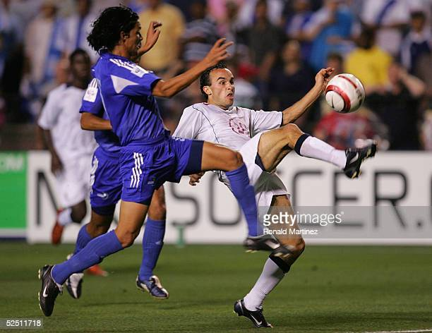 Gustavo Cabrera of Guatemala challenges Landon Donovan of the USA during a 2006 FIFA World Cup qualifying match March 30 2005 at Legion Field in...