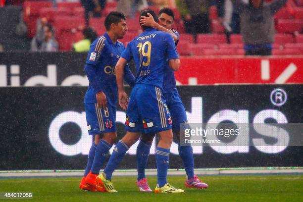 Gustavo Canales of U de Chile celebrates with his teammates after scoring the second goal of his team against Huachipato during a match between U de...