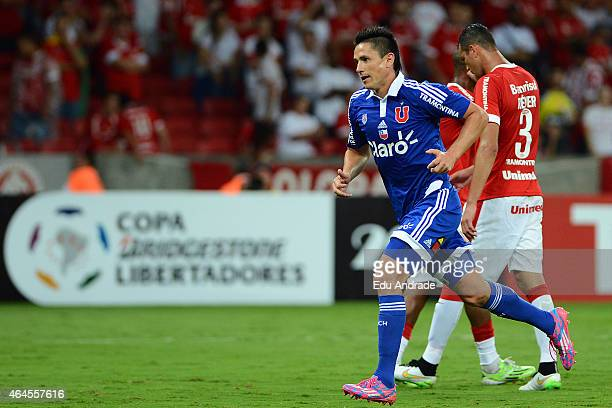 Gustavo Canales of Universidad de Chile celebrates after scoring the first goal of his team during a match between Internacional and U de Chile as...
