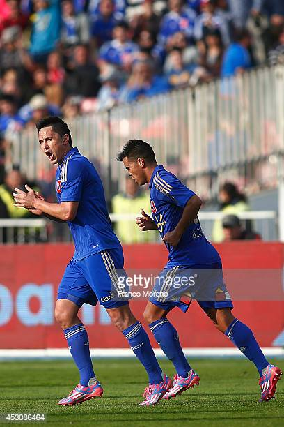 Gustavo Canales of Universidad de Chile celebrates with teammates the second goal of his team during a match between U de Chile and Wanderers as a...