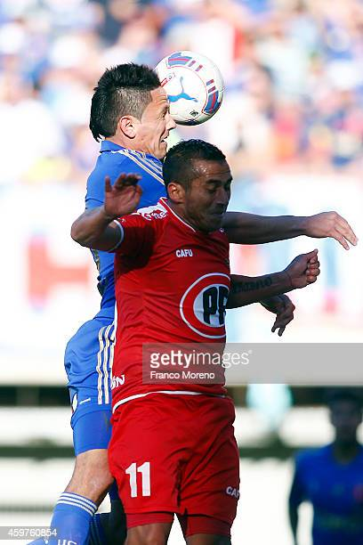 Gustavo Canales of Universidad de Chile fights for the ball with Octavio Pozo of Nublense during a match between Nublense and Universidad de Chile as...