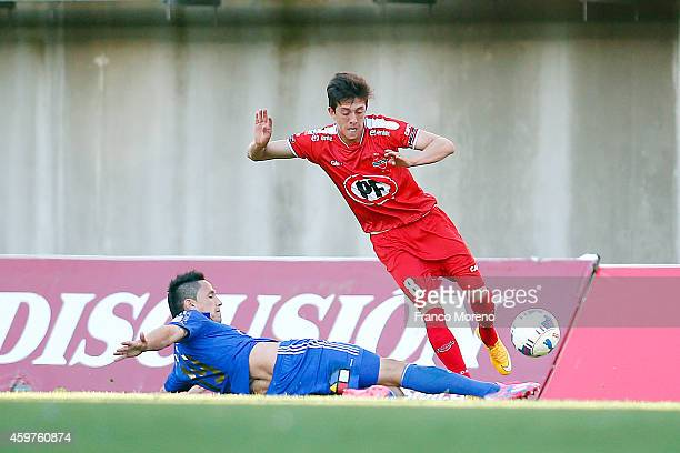 Gustavo Canales of Universidad de Chile fights for the ball with Pablo Parra of Nublense during a match between Nublense and Universidad de Chile as...