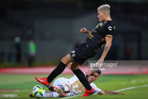 Gustavo Canto of Dorados de Sinaloa struggles for the ball with Felipe Mora of Pumas during the quarterfinals match between Pumas UNAM and Dorados as...