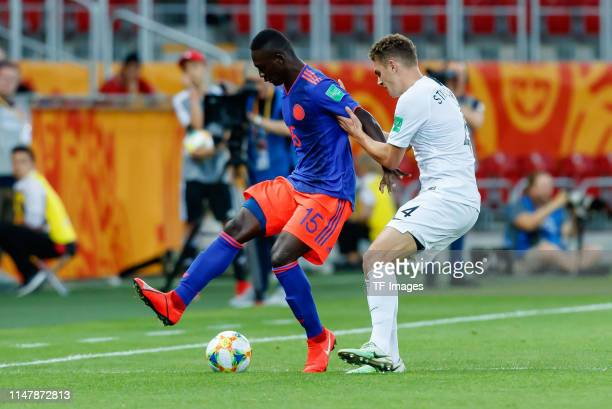 Gustavo Carvajal of Colombia and Gianni Stensness of New Zealand battle for the ball during the 2019 FIFA U20 World Cup Round of 16 match between...