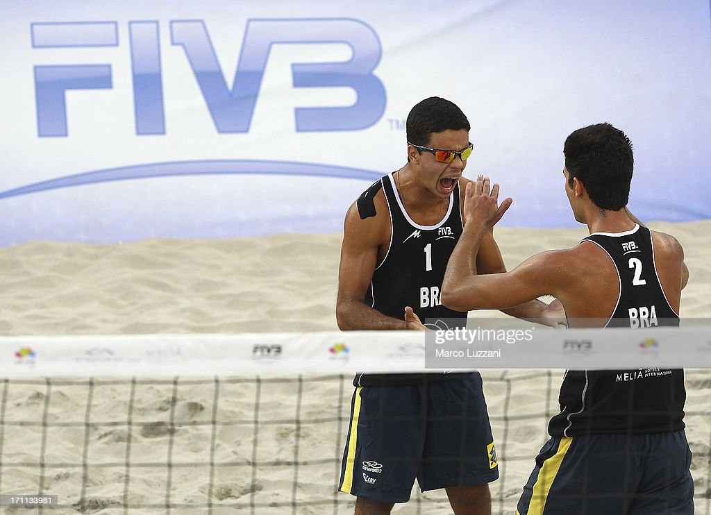 Gustavo Carvalhaes and Allison Francioni of Brazil celebrate a point during FIVB Under 21 World Championships on June 22, 2013 in Umag, Croatia.