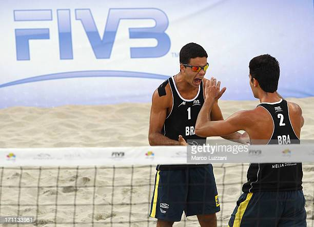 Gustavo Carvalhaes and Allison Francioni of Brazil celebrate a point during FIVB Under 21 World Championships on June 22 2013 in Umag Croatia