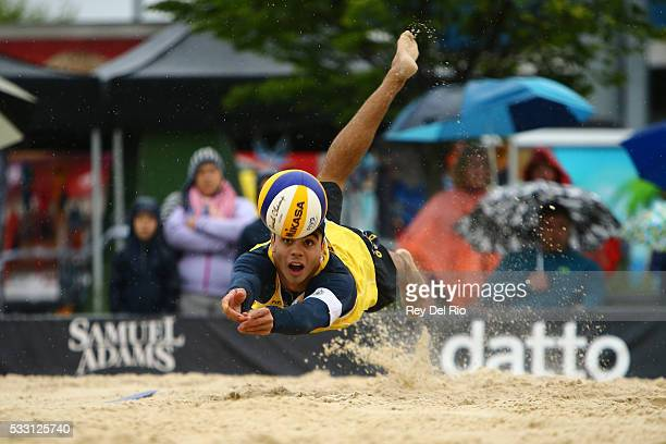 Gustavo Carvalhaes of Brazil dives for the ball during his match against John Hyden and Tri Bourne of the USA during day 4 of the 2016 AVP Cincinnati...