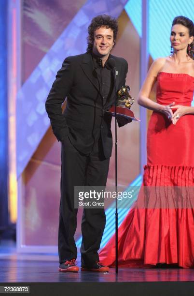 """Gustavo Cerati accepts his award for """"Best Rock Solo Vocal Album"""" from presenter Barbara Palacios on stage at the 7th Annual Latin Grammy Awards at..."""