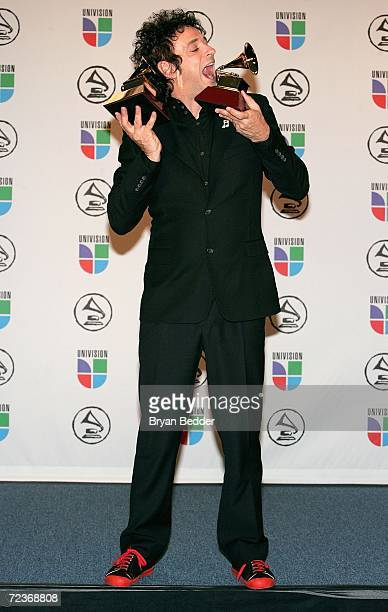 Gustavo Cerati poses with his awards for Best Rock Solo Vocal Album and Best Rock Song in the press room at the 7th Annual Latin Grammy Awards at...