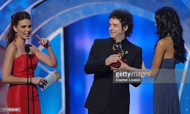 Gustavo Cerati winner Best Rock Song for 'Crimen' with host Barbara Palacios and presenter
