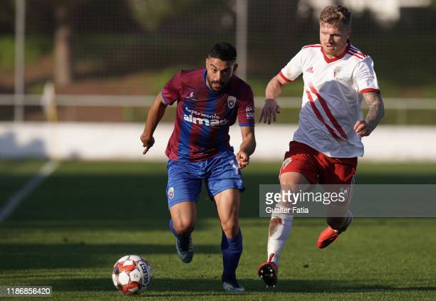 Gustavo Costa of CD Cova da Piedade with Mikita Korzun of UD Vilafranquense in action during the Liga Pro match between CD Cova da Piedade and UD...