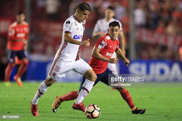 Gustavo Cuellar of Flamengo struggles for the ball with Diego Rodriguez of Independiente during the first leg of the Copa Sudamericana 2017 final...