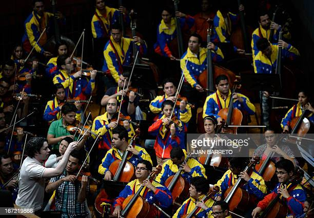 Gustavo Dudamel conducts the Simon Bolivar Symphony Orchestra before the beginning of the swearingin ceremony of the new ministers in Caracas on...