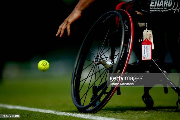 Gustavo Fernandez of Argentina bounces a ball ahead of serving during his match against Stefan Olsson of Sweden during day one of the Surbiton...