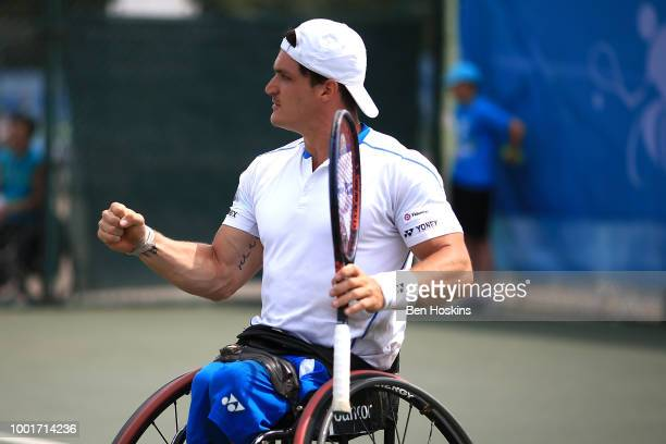 Gustavo Fernandez of Argentina celebrates winning a point during his quarter final match against Takashi Sanada of Japan on day three of The British...