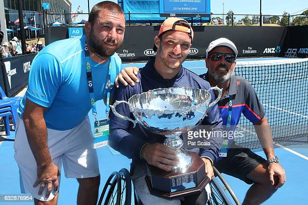 Gustavo Fernandez of Argentina celebrates with the trophy after winning the Wheelchair Singles Final match against Nicolas Peifer of France during...
