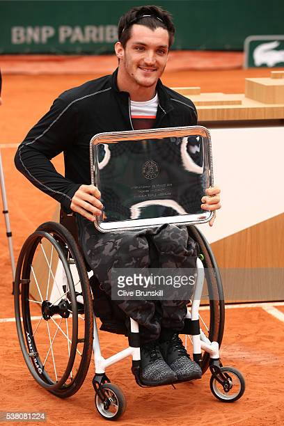 Gustavo Fernandez of Argentina celebrates with the trophy won during the Men's Wheelchair Singles final match against Gordon Reid of Great Britain on...