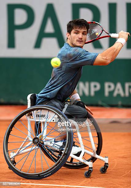 Gustavo Fernandez of Argentina hits a backhand during the Men's Wheelchair Singles final match against Gordon Reid of Great Britain on day fourteen...