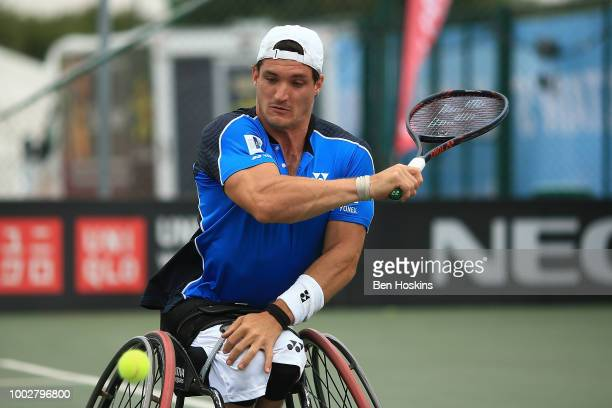 Gustavo Fernandez of Argentina plays a backhand during his semi final match against Shingo Kunieda of Japan on day four of The British Open...