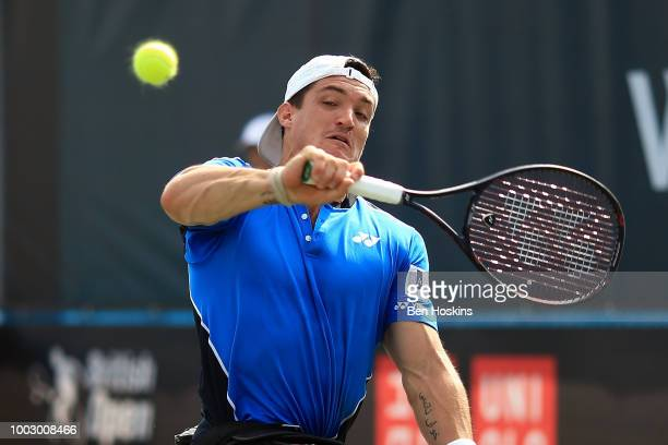 Gustavo Fernandez of Argentina plays a backhand during his semi final match against Shingo Kunieda of Japan on day five of The British Open...