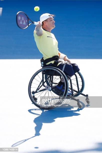 Gustavo Fernandez of Argentina plays a forehand in his Men's Wheelchair Singles quarter final match against Ben Weekes of Australia during day 10 of...