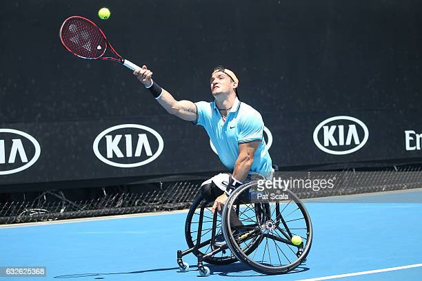 Gustavo Fernandez of Argentina plays a forehand in his Quad Wheelchair match against Ben Weekes of Australia during the Australian Open 2017...