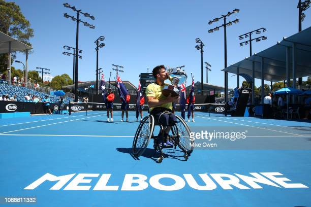 Gustavo Fernandez of Argentina poses with the championship trophy after winning his Men's Wheelchair Singles Final against Stefan Olsson of Sweden...