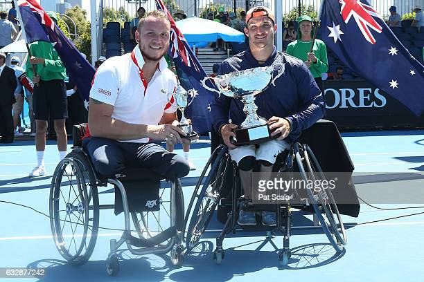 Gustavo Fernandez of Argentina poses with the trophy after winning the Wheelchair Singles Final match against Nicolas Peifer of France posing with...