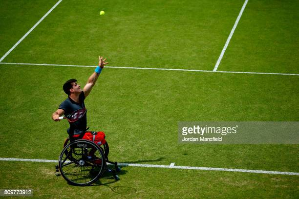 Gustavo Fernandez of Argentina serves during his match against Alfie Hewett of Great Britain during day one of the Surbiton Wheelchair Tennis...