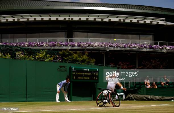 Gustavo Fernandez of Argentina serves during the mens wheelchair semi final against Joachim Gerard of Belgium at the All England Lawn Tennis and...