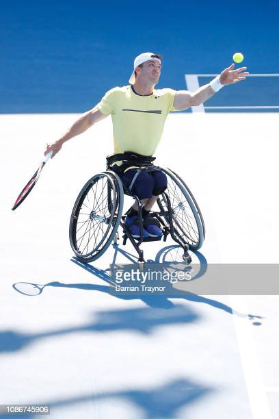 Gustavo Fernandez of Argentina serves in his Men's Wheelchair Singles quarter final match against Ben Weekes of Australia during day 10 of the 2019...