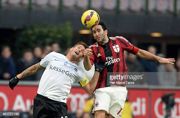 Gustavo German Denis of Atalanta BC competes for the ball with Adil Rami of AC Milan in action during the Serie A match between AC Milan and Atalanta...