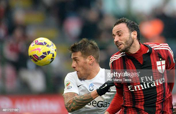 Gustavo German Denis of Atalanta BC competes for the ball with Giampaolo Pazzini f AC Milan in action during the Serie A match between AC Milan and...