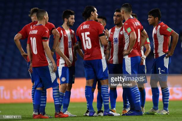 Gustavo Gómez of Paraguay talks with his teammates at the end of the first half during a match between Argentina and Paraguay as part of South...