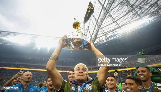 Gustavo Gomez of Palmeiras holds the trophy after winning the Brasileirao 2018 after the match against Vitora at Allianz Parque on December 02 2018...