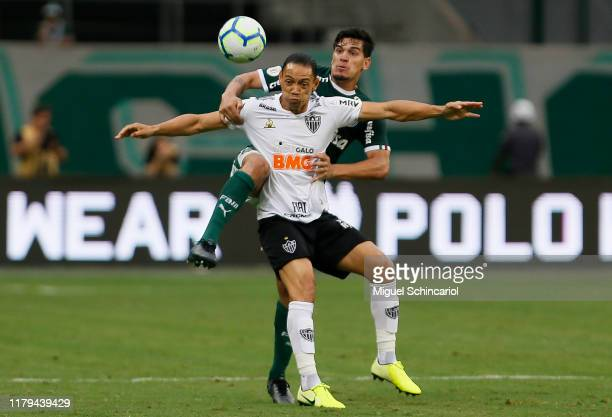 Gustavo Gomez of Palmeiras vies the ball with Ricardo Oliveira of Atletico MG during a match between Palmeiras and Atletico MG for the Brasileirao...