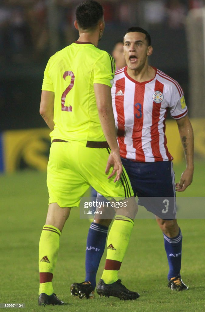 Gustavo Gomez of Paraguay argues with Wilker Angel of Venezuela during a match between Paraguay and Venezuela as part of FIFA 2018 World Cup Qualifiers at Defensores del Chaco Stadium on October 10, 2017 in Asuncion, Paraguay.
