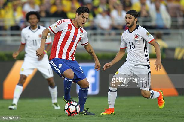Gustavo Gomez of Paraguay controls the ball as Sebastián Pérez of Paraguay defends during a group A match between Colombia and Paraguay at Rose Bowl...