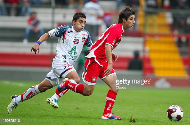 Gustavo Guillen of Irapuato struggles for the ball with Isaac Brizuela of Toluca during a match between Toluca and Irapuato as part of the Copa MX...