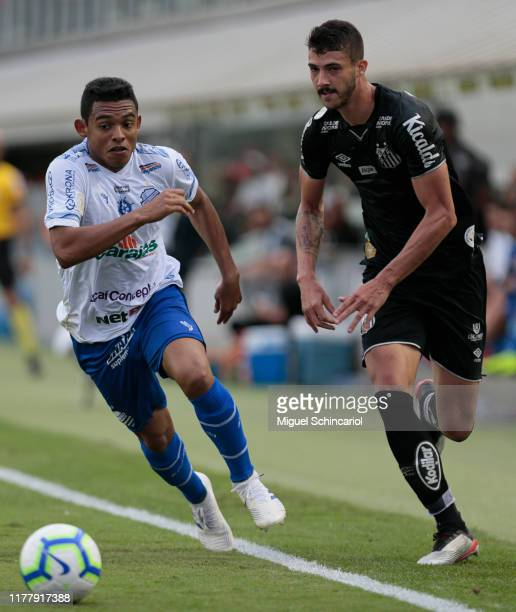 Gustavo Henrique of Santos vies for the ball with Joao Vitor of CSA during a match between Santos and CSA for the Brasileirao Series A 2019 at Vila...