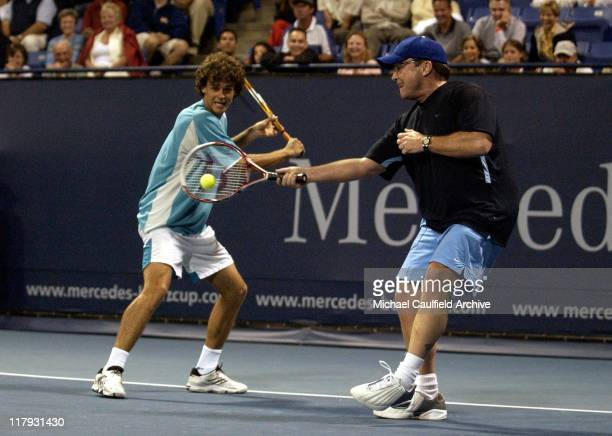 Gustavo Kuerten and Tom Arnold during Gibson/Baldwin Night at The Net ProCelebrity Event Benefiting The MusiCares Foundation to Launch MercedesBenz...