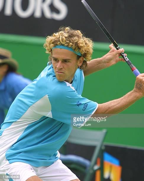 Gustavo Kuerten defeated Hicham Arazi in the first round of the Australian Open 64 76 63